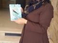 Hanaa Shalabi receives a copy of TPD in which she is featured. Shalabi went on hunger strike and she was later deported to the Gaza Strip #TPD.jpg