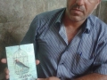 Well-known former Palestinian hunger-striker Ayman Sharawna receives a copy of TPD. Alsharawneh was deported to Gaza.jpg