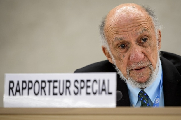 United Nations special rapporteur on the human rights situation in the Palestinian territories Richard Falk presents his final report before the UN Human Rights Council on 24 March 2014 in Geneva (AFP)