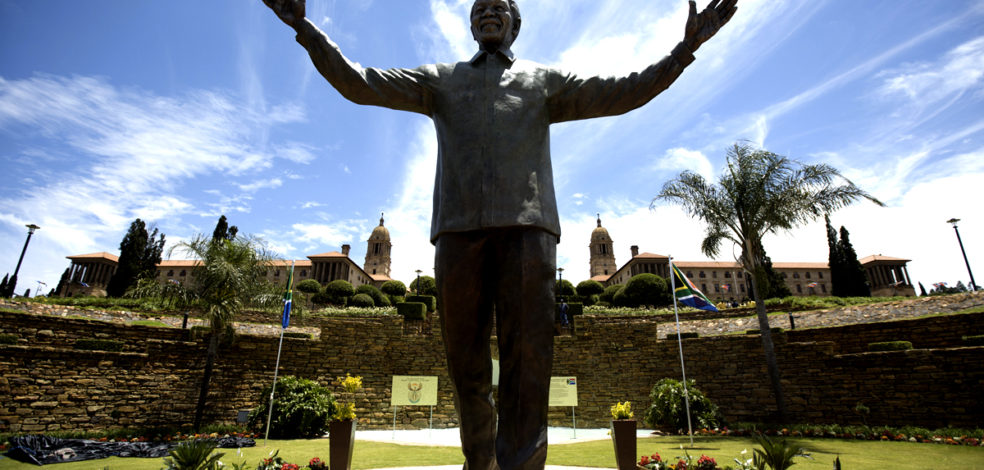 PRETORIA, SOUTH AFRICA - DECEMBER 16:  A statue of former South African president Nelson Mandela is unveiled at the Union Buildings on December 16, 2013 in Pretoria, South Africa.  South African president Jacob Zuma unveiled a 9 meter bronze statue of former South African president Nelson Mandela as part of the Day of Reconciliation celebrations.  (Photo by Oli Scarff/Getty Images)