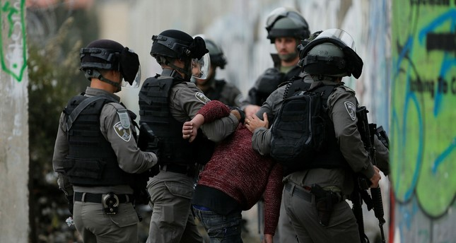 Israeli border police arrest a Palestinian protester during clashes following protests against Trump's decision to recognize Jerusalem as the capital of Israel, in the West Bank city of Bethlehem, Friday, Dec. 22, 2017. (AP Photo)