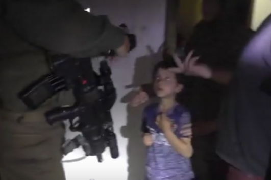 A screenshot from the B'Tselem video documenting the raid on the Da'na family's home in Hebron.