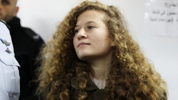 Palestinian teen Ahed Tamimi enters a military courtroom at Ofer Prison, near the West Bank city of Ramallah on Jan. 15, 2018. | Photo: Reuters