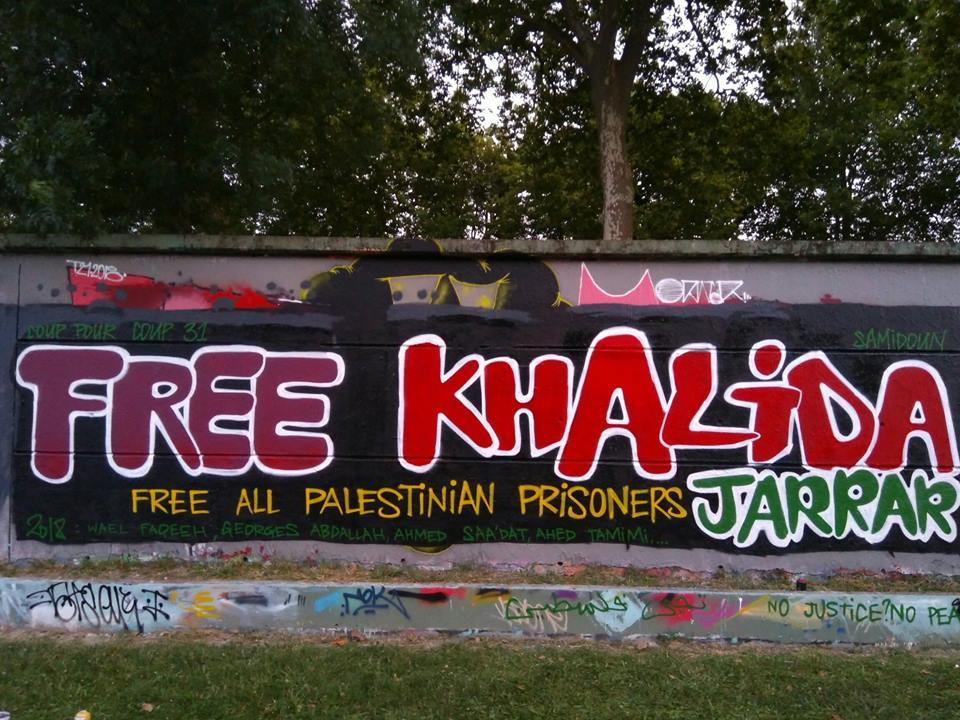 Graffiti in France urging Khalida's release. Photo: Coup Pour Coup 31