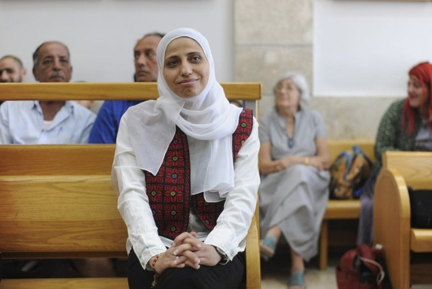 Dareen Tatour sits in a courtroom in Nazareth, Israel (AP)