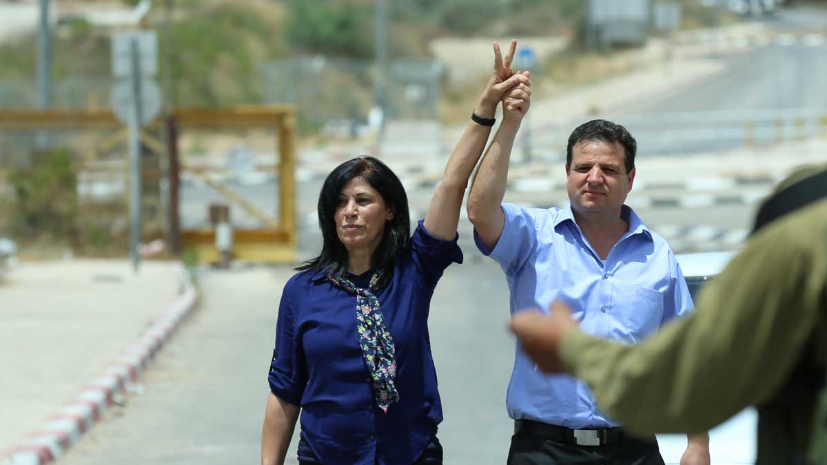 Palestinian parliament member Khalida Jarrar with Arab-Israeli Knesset member Ayman Odeh after her release from Israeli prison on June 3, 2016. (Zher333/CC BY-SA 4.0)