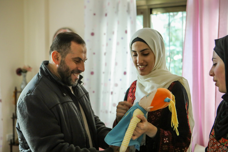 Imad al-Din al-Saftawi with the doll he bought for his daughter Sarah when she was a young girl but was only able to give to her 18 years later. Mohamed Hajjar