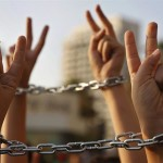 Palestinian boys raise up their hands with chains, during a protest to show their solidarity with hunger striking Palestinian prisoners in Israeli jails, May 4, 2017 [File: Hussein Malla/AP)