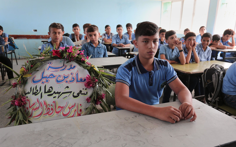 A wreath stands in the place of Faris al-Sarsawi at his school in Gaza City on 7 October 2018. The 13-year-old was fatally shot in the chest by an Israeli sniper two days earlier. Ramadan El-Agha APA images