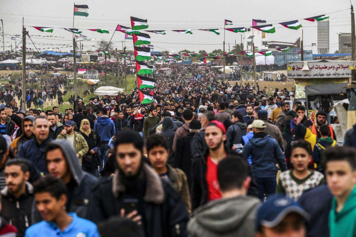 """A Palestinian man shot by Israeli forces during a demonstration near the Gaza-Israel boundary fence has succumbed to his wounds, the health ministry in the besieged coastal enclave said in a statement. Ahmed Mohammed Abdullah al-Qara, 23, was shot in the abdomen during a """"Great March of Return"""" protest east of Khan Yunis on Friday, the health ministry said. Palestinian child shot in head by Israeli forces in West Bank Read More » At least 56 other protesters were treated for injuries at the demonstration, according to the ministry.  38 of those hurt were shot with live rounds or rubber-coated steel bullets, including 22 minors and three women, the ministry added.  A military ambulance was also hit by rubber-coated steel bullets during the march, according to the health ministry.   Palestinians in the Gaza Strip have held regular protests - dubbed the Great March of Return - since March 2018. They are demanding an end to the ongoing siege of the coastal Palestinian territory and to be allowed to return to their ancestral towns and villages in what is now Israel. Israel has been criticised for its heavy-handed response to the protests, with frontline doctors accusing the Israeli army of intentionally maiming Palestinians. In 2018, Israeli forces killed 290 Palestinians, including 55 minors, in the occupied West Bank and Gaza Strip, according to Israeli human-rights group B'Tselem. B'Tselem said that Israel's """"reckless open-fire policy"""" was responsible for a majority of the deaths. The group also accused Israeli forces of implementing a """"shoot to kill"""" policy."""